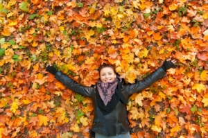 Woman-Layiing-in-Fall-Leaves